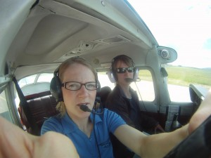 Sarah, my instructor and me messing with the GoPro camera at the hold short line.