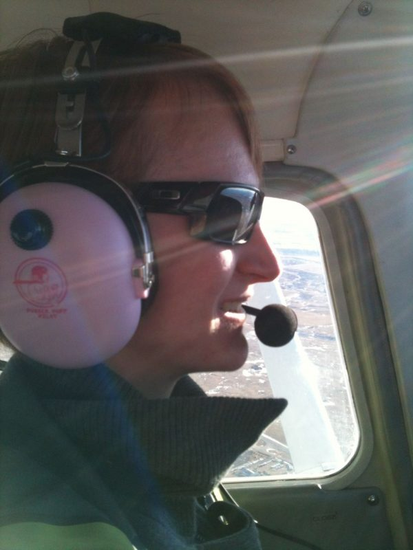 Flying with my pink ANR headset from Powder Puff Pilot.