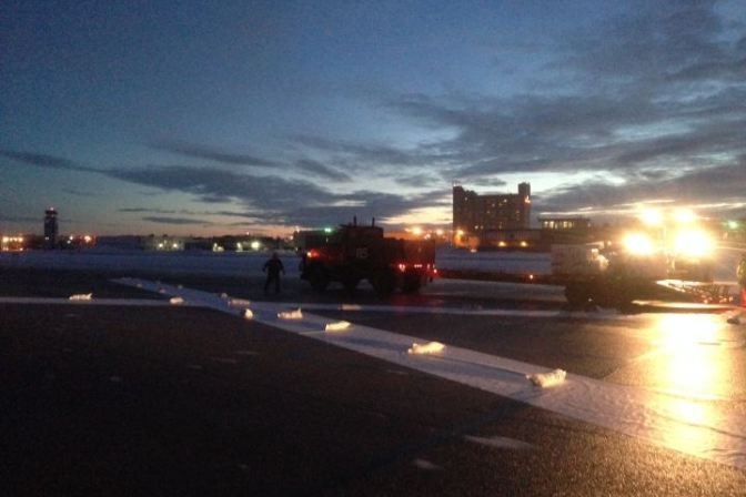 Crews closing the City Centre Airport permanently. Image courtesy of Global News.ca